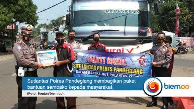 Photo of Peringati HUT ke-65 Polantas, Polres Pandeglang Bagikan 500 Paket Sembako